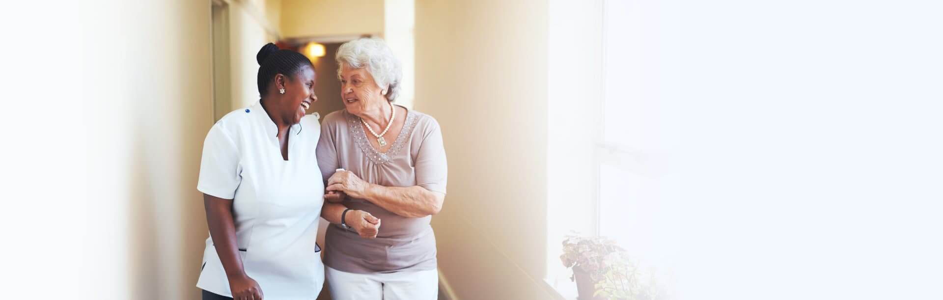 nurse walking with a senior woman